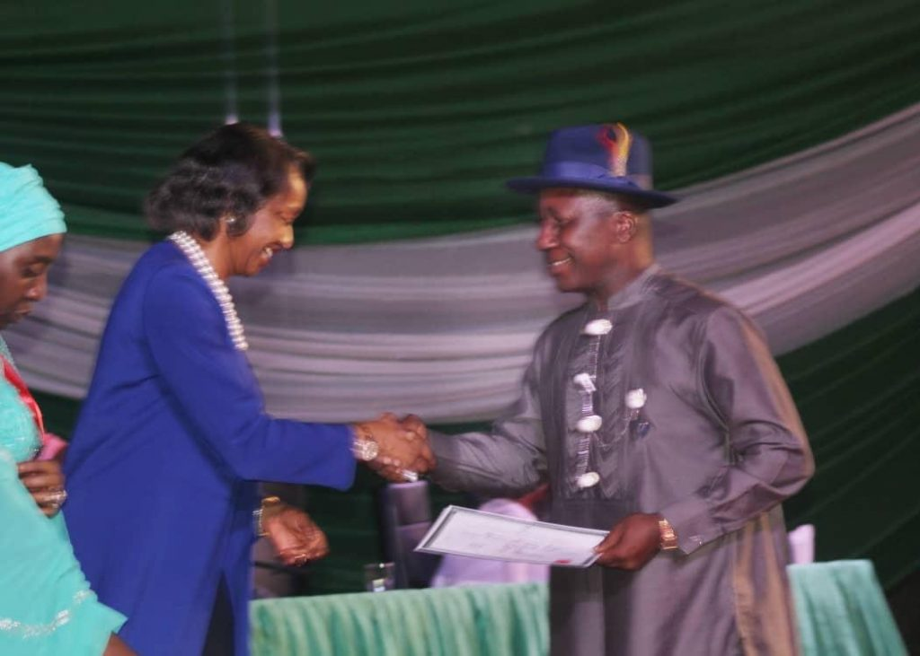 Professor Steve Azaiki receives certificate of return from Mrs Oluwatoyin Babalola Director Legal Services INEC