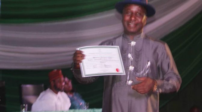Professor Steve Azaiki receives certificate of return from INEC Chairman, PROFESSOR Mahmood Yakubu
